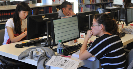 A student in the library takes a practice test.