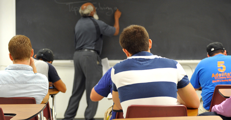 An instructor teaches freshman students.
