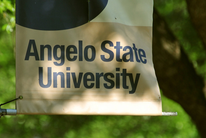 An Angelo State University banner is displayed on campus.