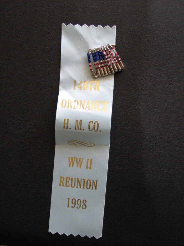 A ribbon from the 1998 reunion of the 140th Ordnance Heavy Maintenance Company.