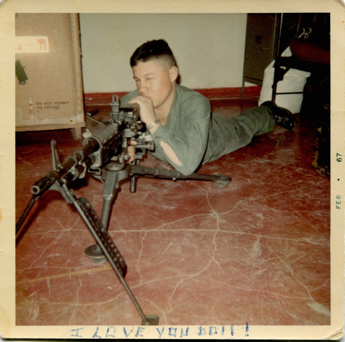 "Guadalupe Carrasco with an M-60 machine gun. As he explains on the back, ""It is a very powerful weapon. In fact it is the last weapon we are going to study."" (Feb. 1967)"