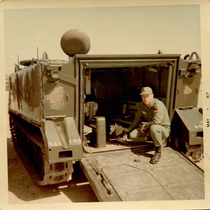 "Guadalupe Carrasco with a Marine Personnel Carrier. As he explained on the back ""It carries 13 combat troops. It weighs 11 tons. It is made of 2 in. of steeal [sic]. It swims in water."" (May, 1967)"