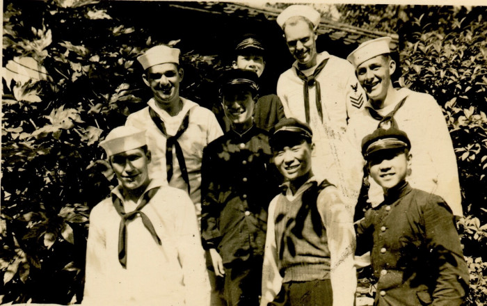 J. W. Young, other American servicemembers, and Japanese high school students who wanted to converse with the American visitors. Image taken in a village near Sasebo, Japan.