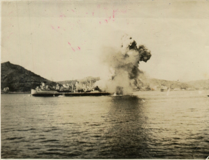An oiler in flames in Sasebo Harbor, Japan.