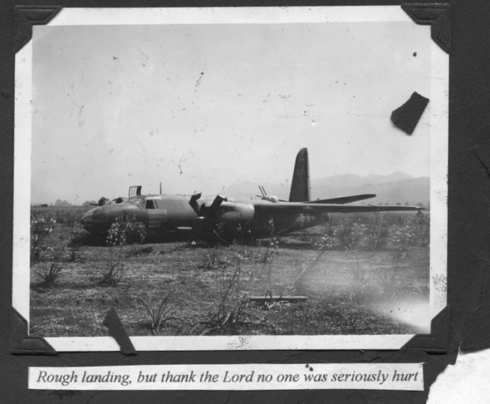 "Photo of a their plane which they had ""bellied in."" Caption reads, ""Rough landing, but thank the Lord ..."