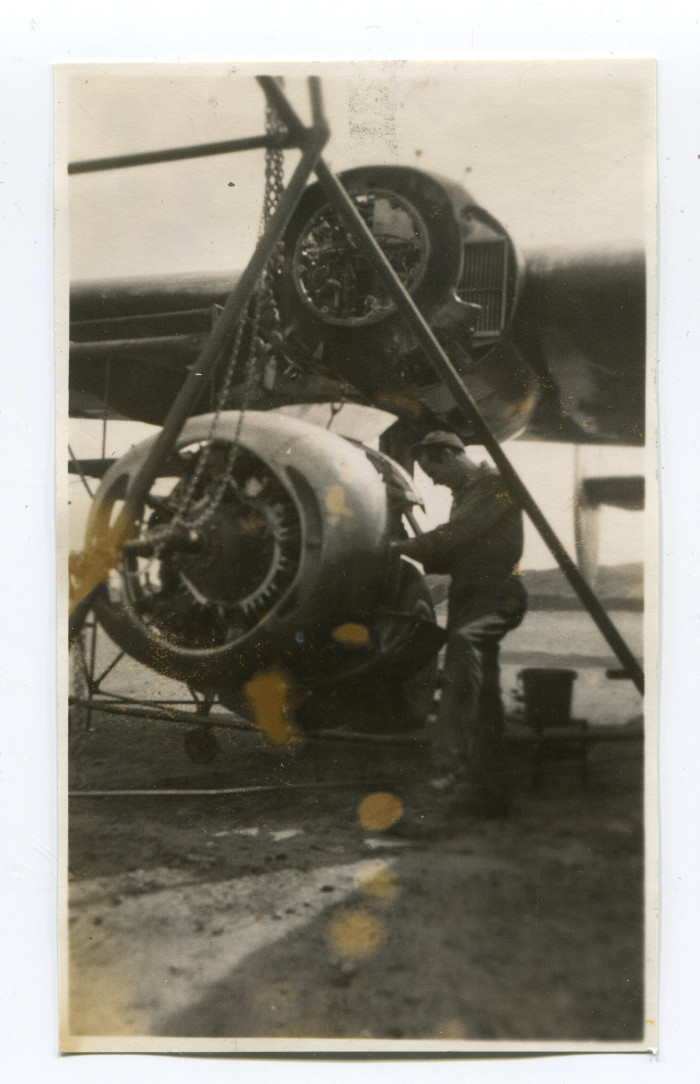 Soldier working on the engine of a plane