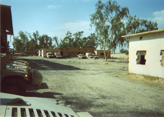 Photo of military vehicles parked at what seems to be a base.