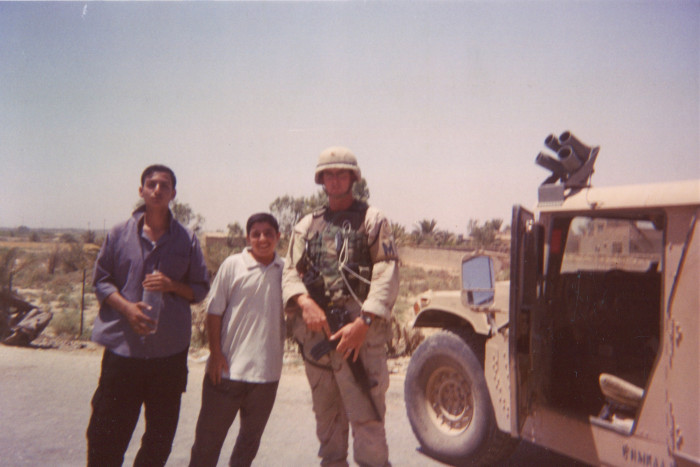 Photo of soldier with two Iraqi boys
