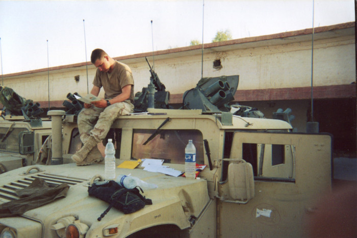 Photo of soldier sitting on top of Humvee