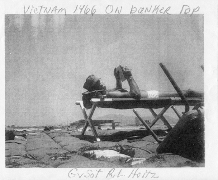 Photo of R.L. Holtz lying on top of the bunker. Taken in Vietnam 1966.