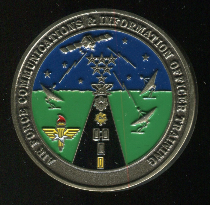 Air Force Communications coin. Side A shown. Spooner has a background in communications work.