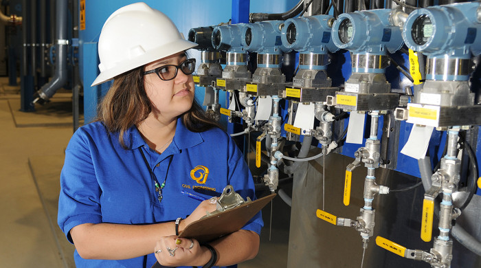 Ramgineering student taking pressure measurements at San Angelo water treatment plant (2016)