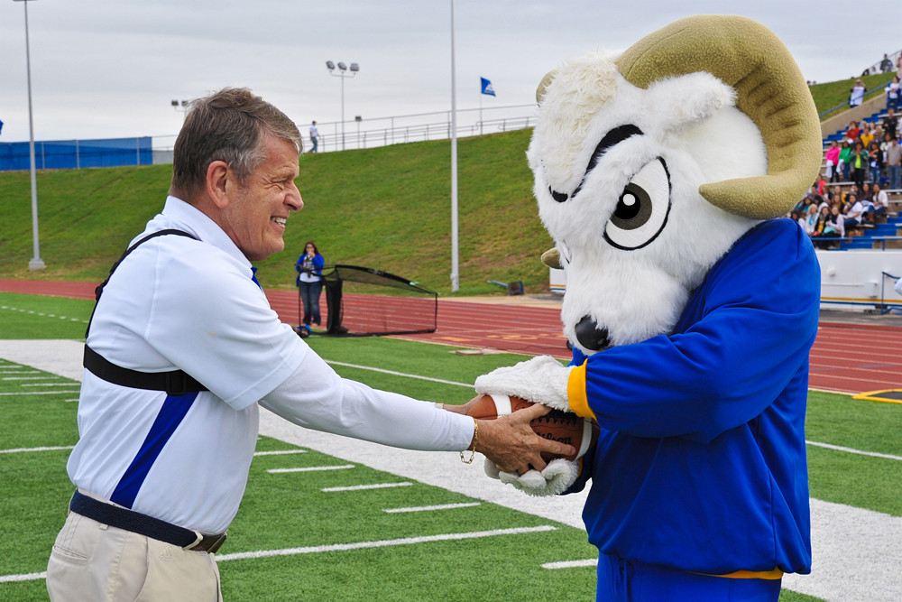 Fred Key delivers the first game ball to Roscoe at the new stadium complex.