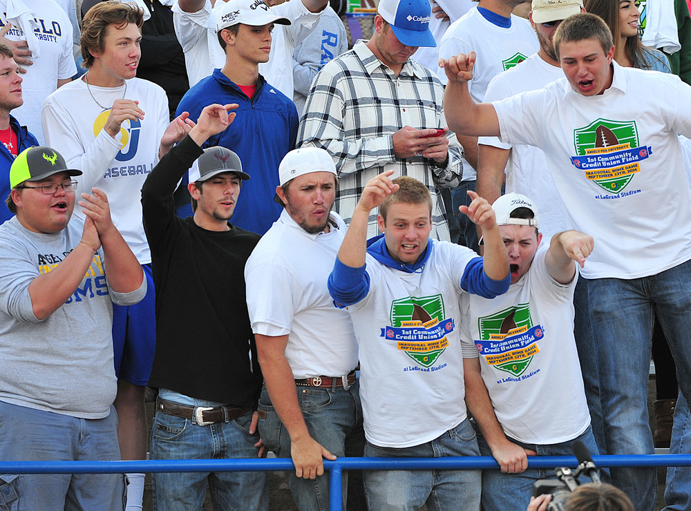 Students support their team and wear Home Turf Advantage game day shirts provided by 1st Community Federal Credit Union.