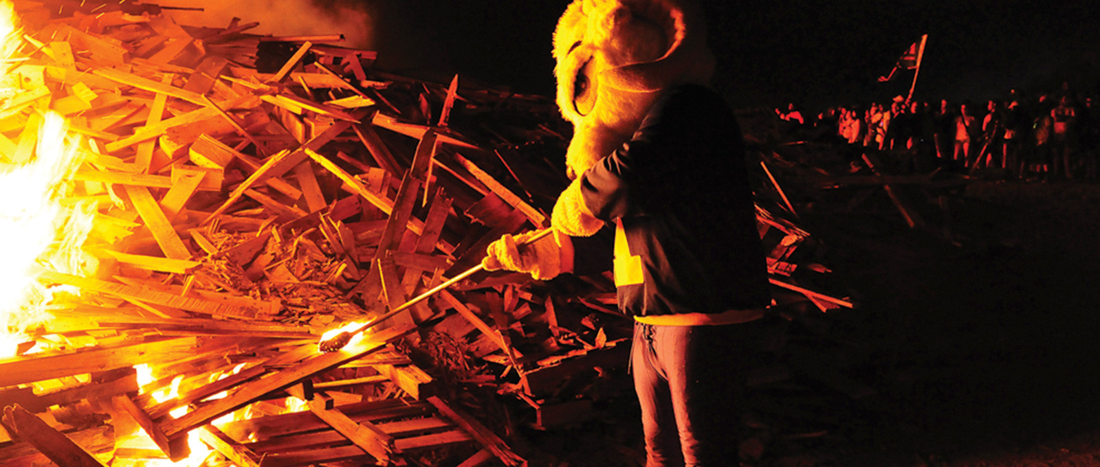 Roscoe D. Ram helps light the Homecoming Bonfire, a longstanding tradition at Angelo State University. Symbolically, Rosco...