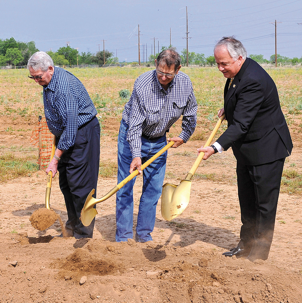 Norm Rousselot, Richard Mayer and President Brian J. May turn the first dirt for construction of the Mayer- Rousselot Agri...