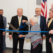 Mary Louise Strain cuts the grand opening ribbon