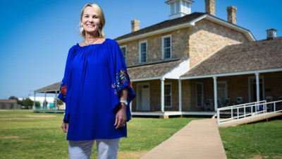 Lori Barton: Lori Barton, classes of 1999 & 2005, stands in front of the historic Fort Concho.