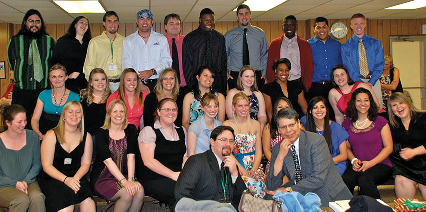 Dr. Darin Carroll (front left) and Dr. Crosby Jones gather with ASU students at the Tri-Beta South Central Regional Convention in April 2010.