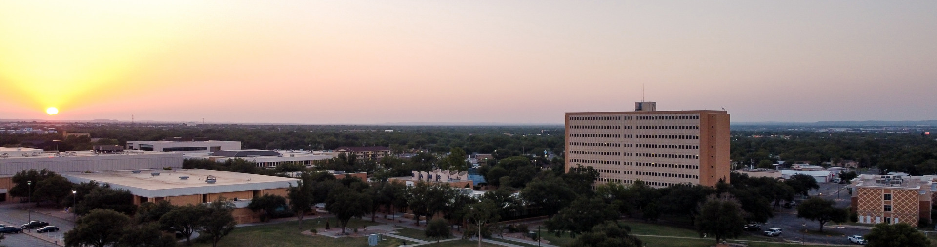 Aerial shot of Concho and Plaza Verde resident halls at dusk