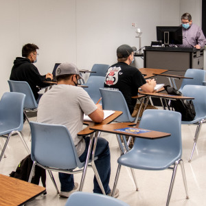 students and professor in classroom