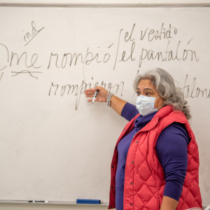 professor writing on white board