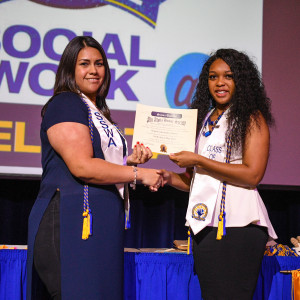 Social Work students receiving pins and awards during pinning ceremony