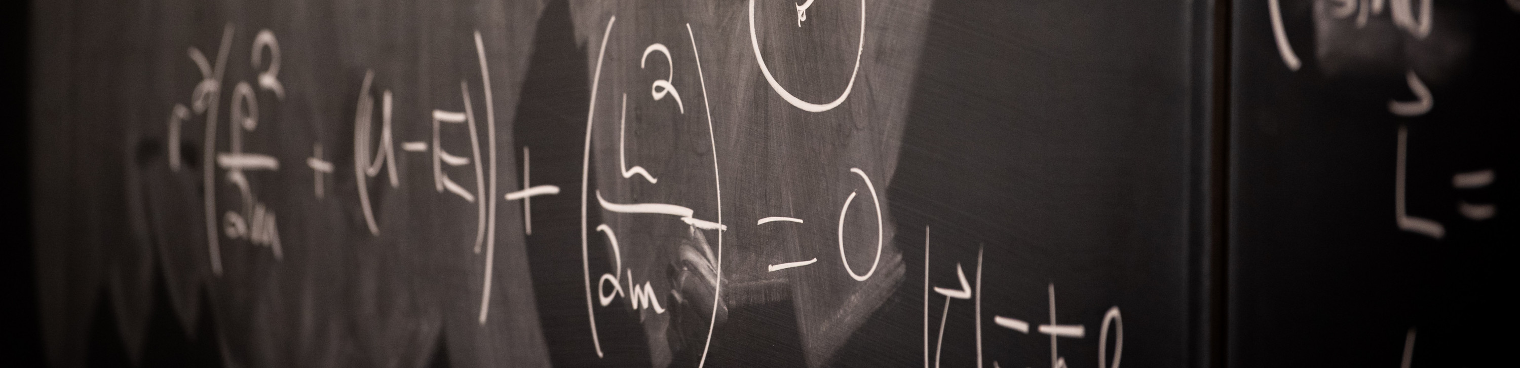 chalkboard with mathematical equation