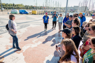 Group of students listening to a tour guide in Portugal