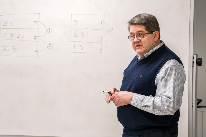 professor at whiteboard