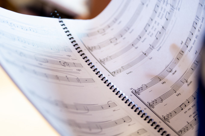 notebook with music sheet