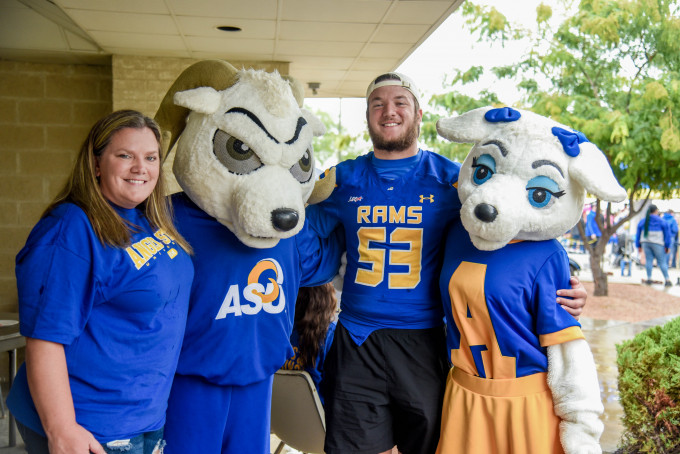 Roscoe and Bella with football player and fan