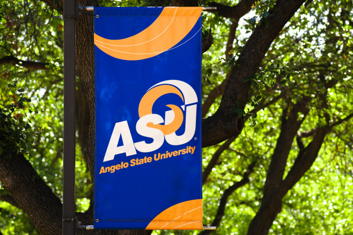 A vibrant blue and gold banner on the Angelo State University mall.
