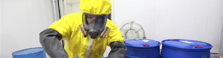 Professional in uniform works with hazardous materials