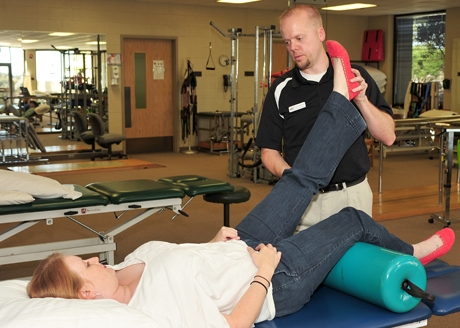 Physical therapy student Brent Asfford treats a patient.