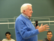 Coach Phil George speaks to an audience at an event commemorating the 50th anniversary of the Civil Rights Movement.