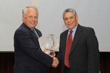 Angelo State President Brian May presents Dr. De León with an award honoring his 40 years of service to the university.