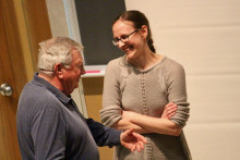 Prof. Allison Robbins speaks with a guest at the Great War Series event on March 22, 2018.
