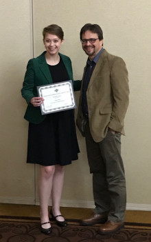 History major Keely Shaw accepts her award from Randy Whited, president of the Texas State Geneal...