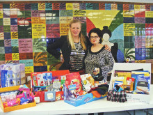 Becca Edens (Meals for the Elderly) accepts donations from Autumn Barnes (Porter Henderson Library)