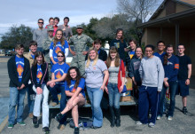 The Honor's Student Association and ROTC Detachment 847 help with book sale.