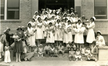 Nurses with babies at San Angelo Hospital