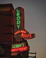 Leddy's Boots sign with neon lights at dusk