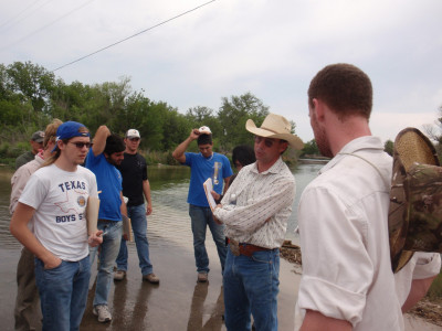 Dr. Ward discussing hydrology with some of our students.