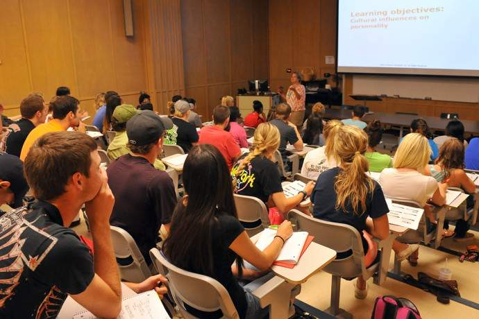 Students attend class to work toward their psychology degree.