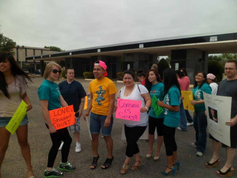 Students participating in the 2013 Walk a Mile in Her Shoes fundraiser.
